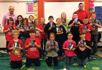 Goshen Community Grange presents dictionaries to Kenton third graders