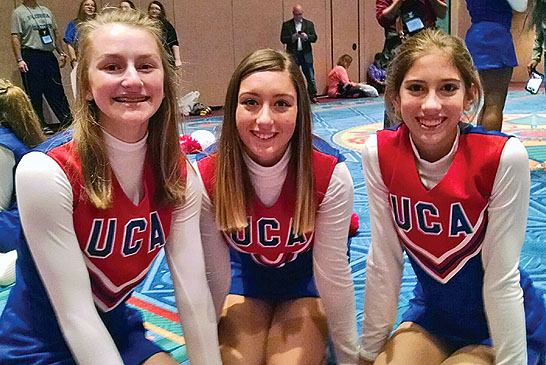 Three local cheerleaders perform at Disney World