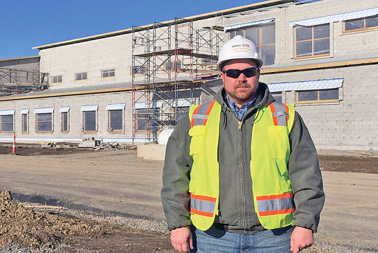 J. Mac Geissinger stands in front of Ridgemont's new school