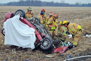 Car-semi crash kills 4