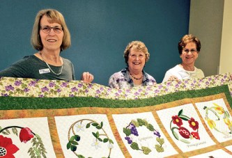 Retired teachers learn about quilt