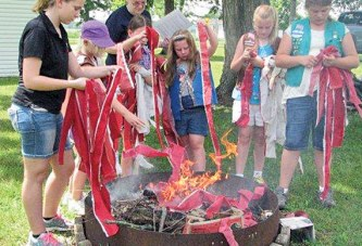 Dunkirk Girl Scouts help to retire flags