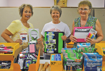 Kids Day activities, school supplies keep Helping Hands busy