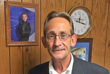 Kentonite enjoys job in prosecutor's office, but always has time for son
