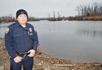 KPD officer rescues woman who drove car into France Lake