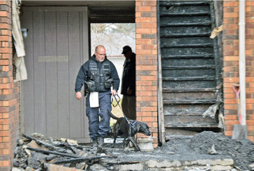 Fire officials investigate cause of apartment blaze