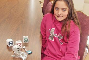 Girl donates Shuffles