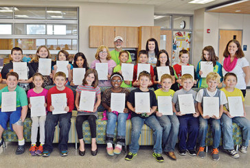 Ridgemont students create books for Haitian orphans