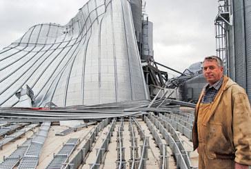 Wind flattens farmer's grain storage system