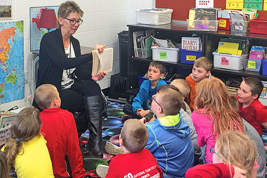 Carol McKinley reads to students