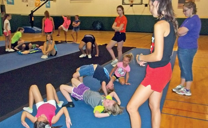 YMCA campers learn about tumbling and gymnastics