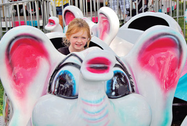 Rainy weather holds down crowd at the fair