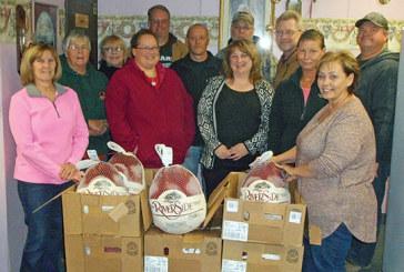 Helping Hands volunteers preparing free holiday feast