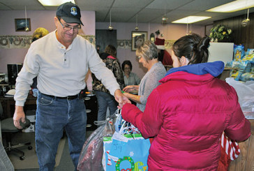 Needy county residents get assistance with food, holiday gifts