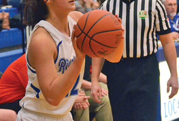 Tigers get hot hand in second quarter, defeat Falcons 57-47