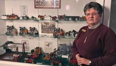 Museum director Linda Iams at the Kenton Toys display