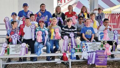 Members of Ada Barnyard Farmers with their fair awards