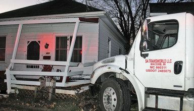Truck hits homes