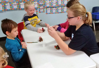 Youngsters make pinecone turkeys at Super Silly Saturday