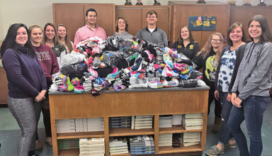 Kenton-OHP FFA members gather around results of sock drive