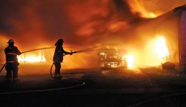 Firefighters battle the blaze at 279 E. Hale St., Ridgeway on Monday night.