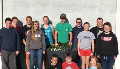Jumbo Jr. Farmers planted flowers in the Sheep Barn flower pots.