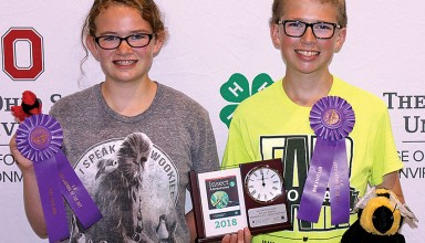 Mariann and Carl Woodruff display awards received during 4-H Natural Resources Day at Ohio State Fair