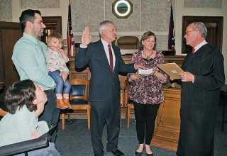 Striker sworn in