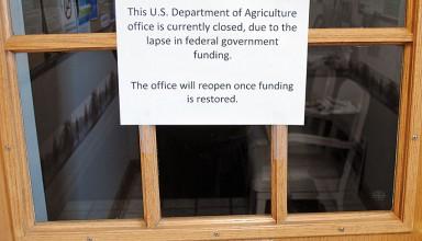 Sign advises USDA patrons of the Kenton office's closing